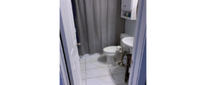 Bathroom with toilet, pedestal sink and tub/shower combo