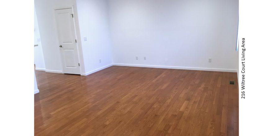 Living area with hardwood floors and window