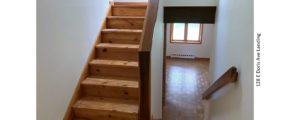 Stair landing with wood stairs and railings