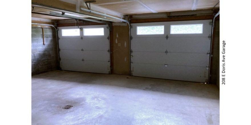 Garage with two garage doors.