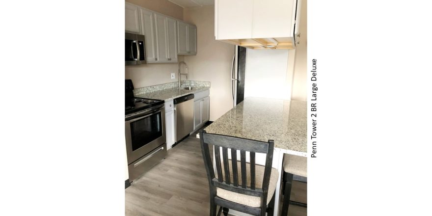 Kitchen with stainless steel appliances and counter seating