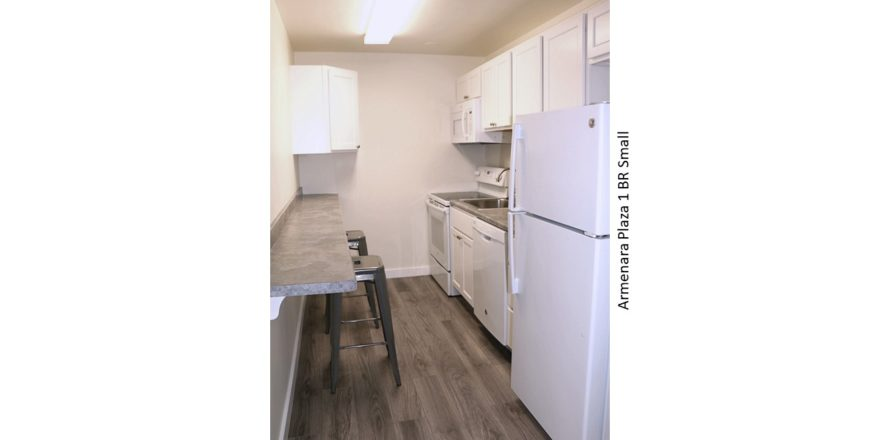Galley kitchen with range oven, microwave, dishwasher, and refridgerator